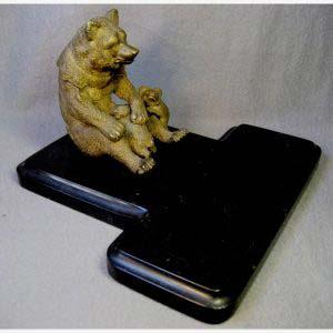 """Письменный настольный прибор """"Медведи"""". Комплектность: шесть предметов. Бронза, патинирование, мрамор. Россия, XIX век. Чернильница. Высота: подиум (мрамор): 2,5 см; медведица: 3,5 см; длина ложемента для письменных приборов: 22 см. Подсвечник. Высота: подиум (мрамор): 2,5 см; подсвечник: 21 см; подиум: 9,5х13 см. Спичечница. Высота: подиум (мрамор): 2,5 см; медведь: 17 см; подиум: 10,5х7,5 см. Пепельница. Высота: подиум (мрамор): 2,5 см; медведь: 10,5 см; диаметр пепельницы 8 см; подиум: 10,5х7,5 см. Пресс-папье. Общая высота: 9 см; высота медведя: 4 см; длина: 14 см; ширина: 6,5 см."""