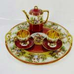 Кофейный набор «тет-а-тет». Фарфор, деколь с ручной дорисовкой, золочение. Государственная Венская мануфактура; период 1860-1864 годы.