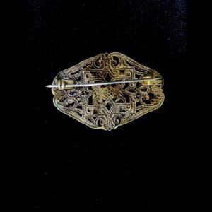 """Брошь. Металл, стразы, покрытие кристаллов в технике Aurora Borealis (""""северное сияние""""). Франция, 50-60 е годы ХХ века. Размер: 3,5х5,5 см."""